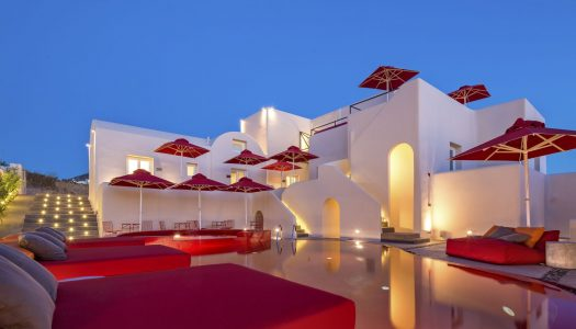 A hotel pool colored in Red, breaks the rules in the Cyclades!